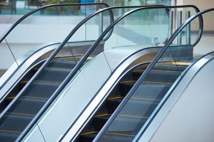 escalator-and-empty-modern-shopping-mall-interior (1) (1) (1)