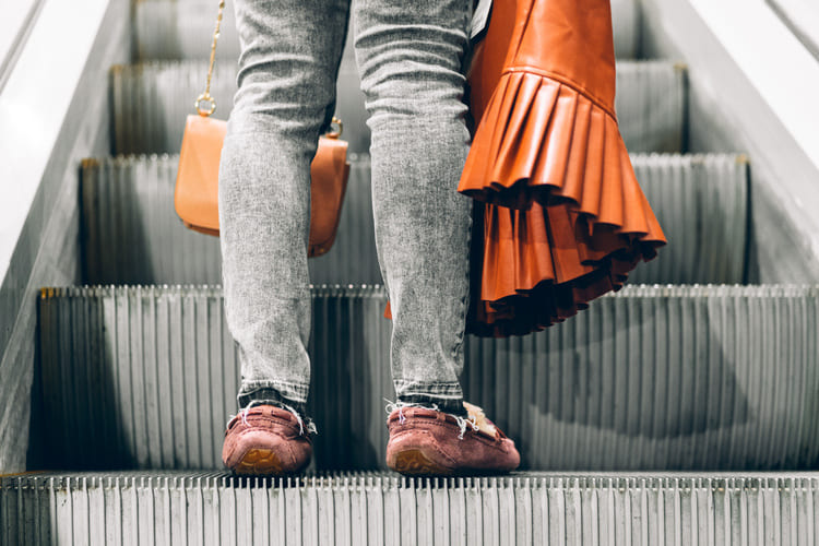 legs-standing-on-the-escalator-of-shopping-mall (2) (1) (1) (1)